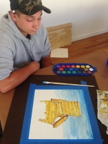 Collin finishes his chair watercolor.