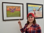 Brittany proudly shows which pieces are hers MNA Exhibition 2017