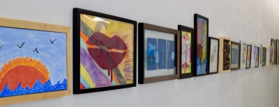 Wall of hung art works at the MNA Foster Youth Exhibition 2017